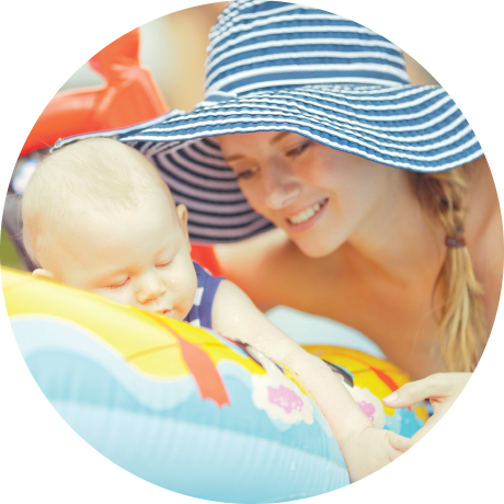 Mother with baby floating on safe pool water system
