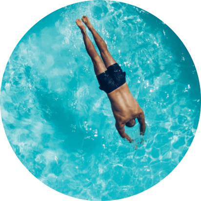 Man jumping in a safe water system pool
