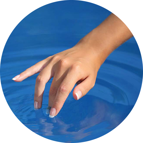 Woman's hand touching pool water