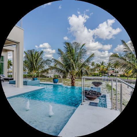 Luxury pool with palm trees around