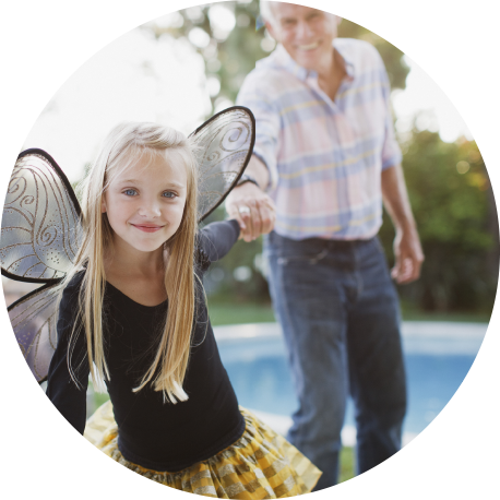 Little girl in a butterfly costume with grandpa